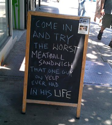 funny yelp review sign
